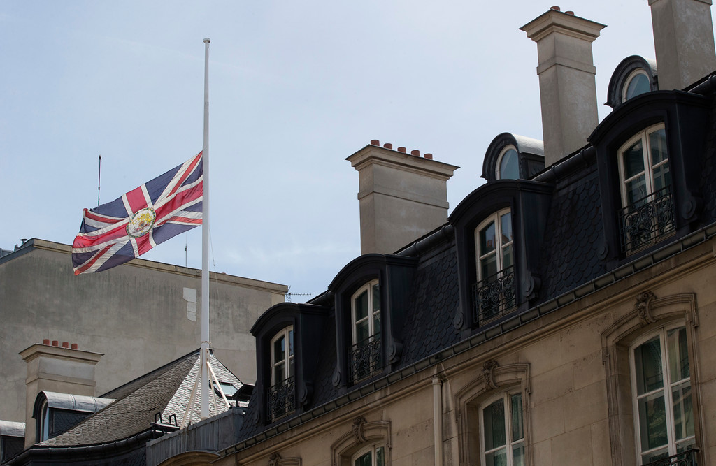 . The Union flag flies at half mast outside the British Embassy in Paris, Tuesday, May 23, 2017. An apparent suicide bomber attacked an Ariana Grande concert as it ended Monday night, killing over a dozen people among a panicked crowd of young concertgoers. (AP Photo/Michel Euler)
