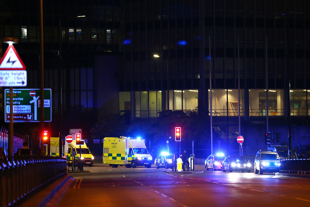 . MANCHESTER, ENGLAND - Emergency services arrive  close to the Manchester Arena on May 23, 2017 in Manchester, England.  There have been reports of explosions at Manchester Arena where Ariana Grande had performed this evening.  Greater Manchester Police have have confirmed there are fatalities and warned people to stay away from the area. (Photo by Dave Thompson/Getty Images)