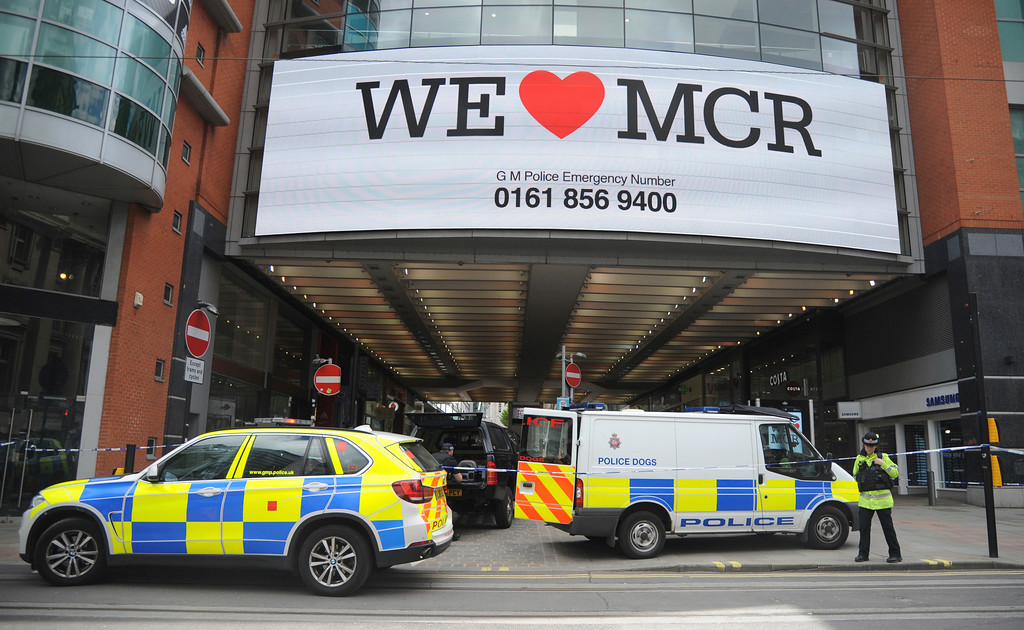 . Police evacuate the Arndale shopping centre, in Manchester, England Tuesday May 23, 2017, the day after an apparent suicide bomber attacked an Ariana Grande concert as it ended Monday night, killing over a dozen of people among a panicked crowd of young concertgoers. (AP Photo/Rui Vieira)