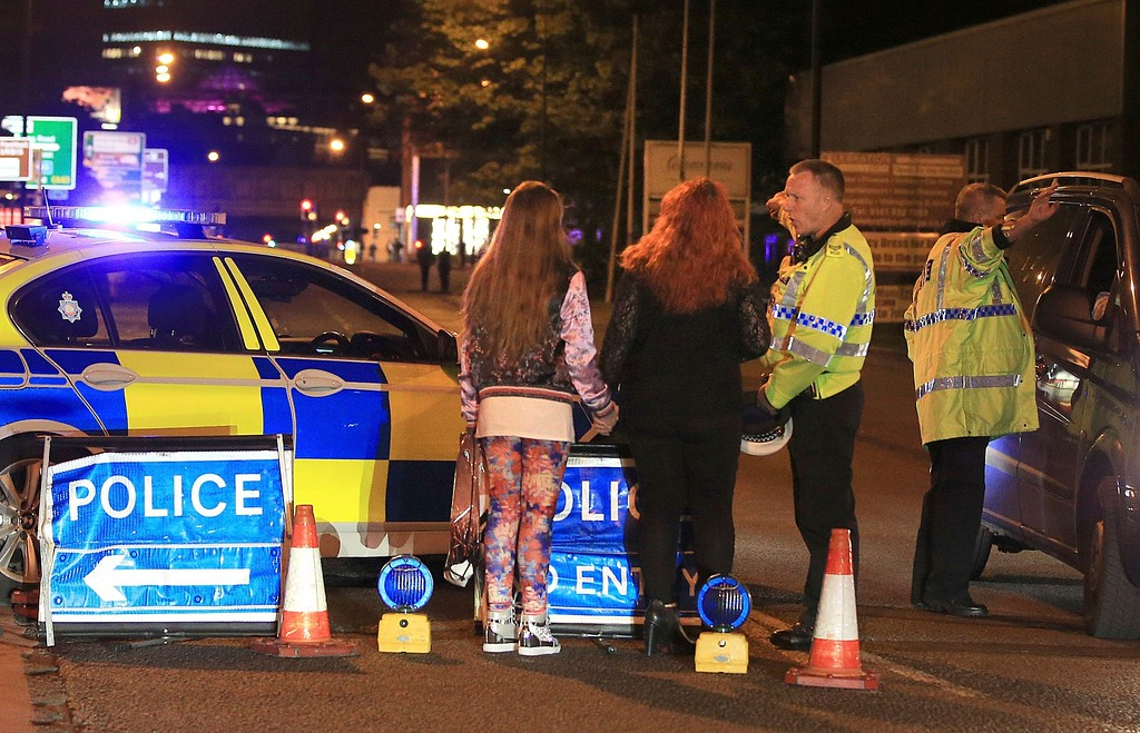 . Police work at Manchester Arena after reports of an explosion at the venue during an Ariana Grande gig in Manchester, England Monday, May 22, 2017. Several people have died following reports of an explosion Monday night at an Ariana Grande concert in northern England, police said. A representative said the singer was not injured. (Peter Byrne/PA via AP)