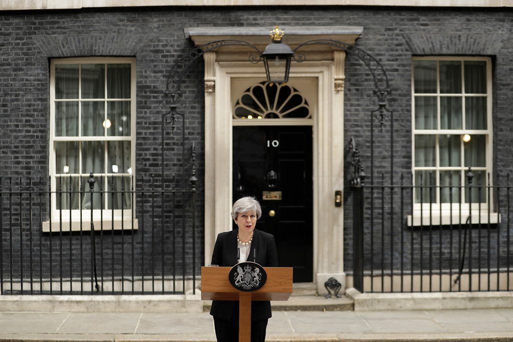 . British Prime Minister Theresa May addresses the media outside 10 Downing Street, London, Tuesday May 23, 2017, the day after an apparent suicide bomber attacked an Ariana Grande concert as it ended Monday night, killing over a dozen of people among a panicked crowd of young concertgoers. (AP Photo/Matt Dunham)