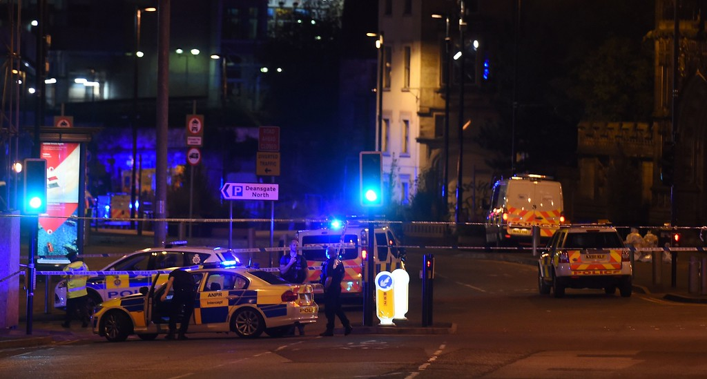 ". Police deploy at scene of a reported explosion during a concert in Manchester, England, on May 23,  2017. British police said early May 23 there were ""a number of confirmed fatalities\"" after reports of at least one explosion during a pop concert by US singer Ariana Grande. Ambulances were seen rushing to the Manchester Arena venue and police added in a statement that people should avoid the area. (PAUL ELLIS/AFP/Getty Images)"