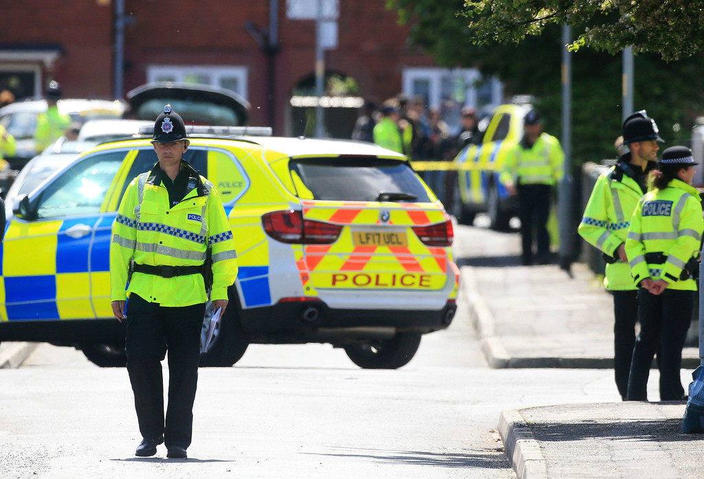 . Police attend the scene following an arrest in Chorlton, south Manchester, England, Tuesday May 23, 2017. Greater Manchester Police say they have arrested a 23-year-old man in connection with the apparent suicide bombing at an Ariana Grande concert in the city on Monday night. (Danny Lawson/PA via AP)