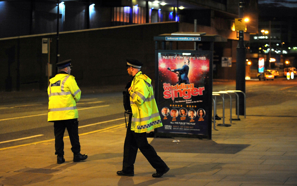 . Police block a road near to the Manchester Arena in central Manchester, England Tuesday, May 23, 2017. An explosion struck an Ariana Grande concert in northern England late Monday, killing over a dozen people and injuring dozens in what police say they are treating as a terrorist attack. (AP Photo/Rui Vieira)