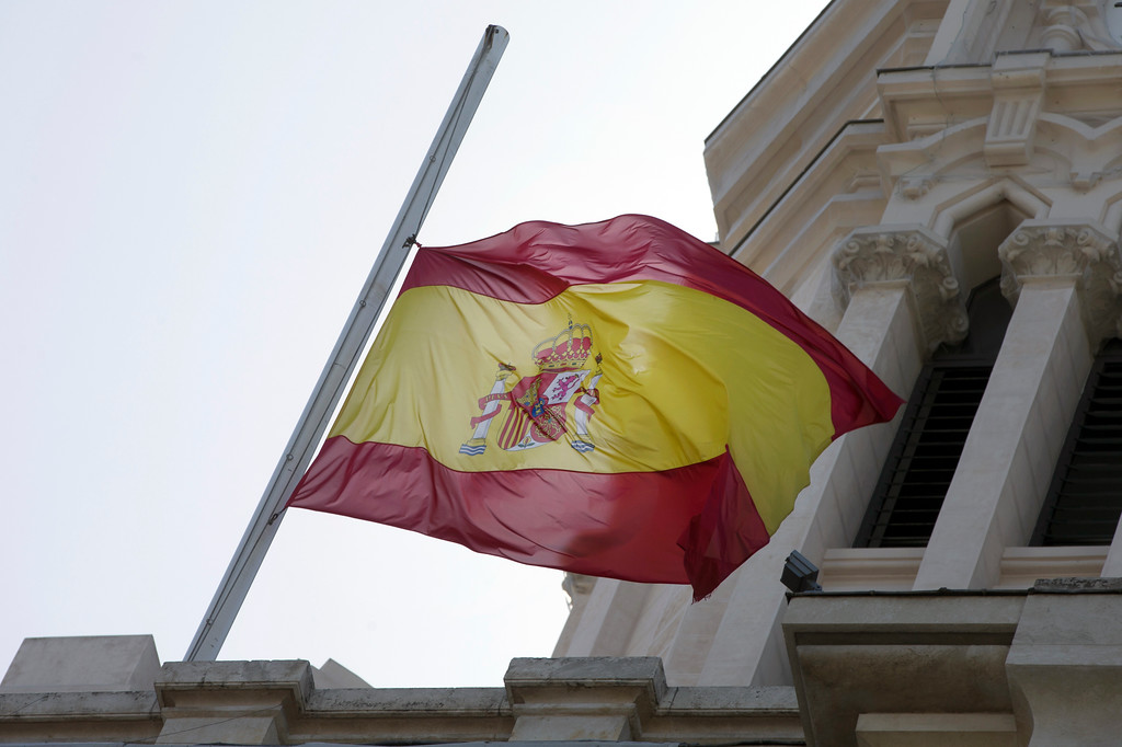 . A Spanish flag flies at half-staff on the roof of the City Hall in Madrid, Spain, Tuesday, May 23, 2017. Flags were set at half-staff to remember those killed and injured in the attack at an Ariana Grande concert in Manchester on Monday night as the Spanish government condemned the deadly explosion. (AP Photo/Paul White)