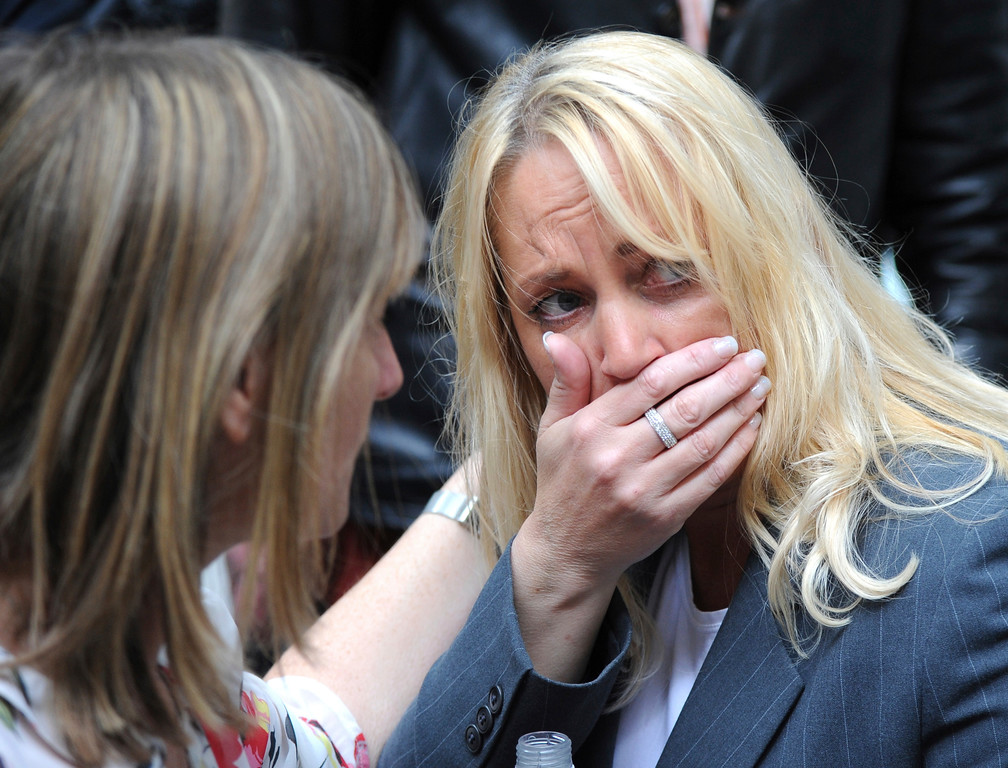 . A member of the public reacts as police evacuate the Arndale shopping centre, in Manchester, England Tuesday May 23, 2017, the day after an apparent suicide bomber attacked an Ariana Grande concert as it ended Monday night, killing over a dozen of people among a panicked crowd of young concertgoers. (AP Photo/Rui Vieira)