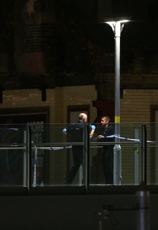 . MANCHESTER, ENGLAND - MAY 23: Police corden off an area close to the Box Office entrance to the Manchester Arena on May 23, 2017 in Manchester, England.  There have been reports of explosions at Manchester Arena where Ariana Grande had performed this evening.  Greater Manchester Police have have confirmed there are fatalities and warned people to stay away from the area. (Photo by Dave Thompson/Getty Images)