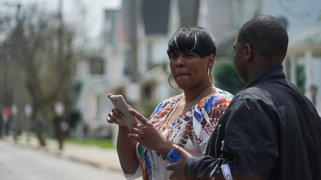 . Alexis Lee, a childhood friend of Steve Stephens, speaks with a neighbor near Stephens\' childhood home in Cleveland, Ohio, Monday, April 17, 2017. Authorities in Cleveland have expanded their manhunt nationwide for Stephens, a man suspected of gunning down a retiree and posting a video of the crime on Facebook. (AP Photo/Dake Kang)