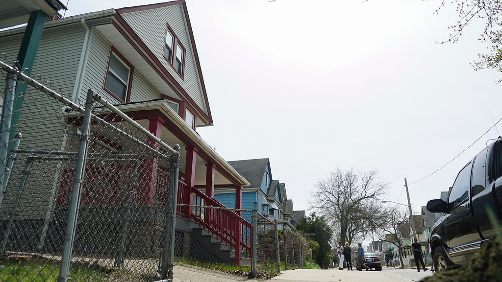 . Steve Stephens\' childhood home, left, is shown as neighbors chat down the street in Cleveland, Ohio, Monday, April 17, 2017. Authorities in Cleveland have expanded their manhunt nationwide for Stephens, a man suspected of gunning down a retiree and posting a video of the crime on Facebook. (AP Photo/Dake Kang)