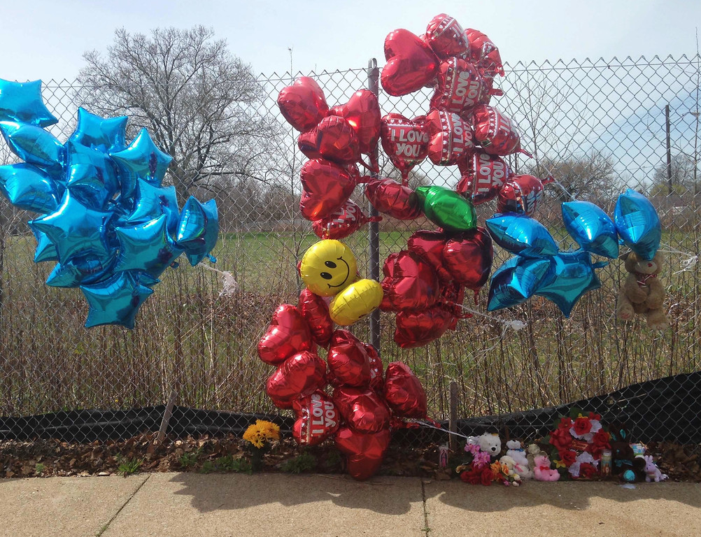 . A makeshift memorial sits along a fence Monday, April 17, 2017, near where Robert Godwin Sr., was killed in Cleveland. Police said Steve Stephens killed Godwin on Sunday and posted the video on Facebook. (AP Photo/Mike Householder)