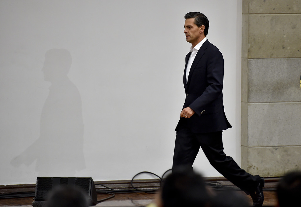 . Mexico\'s President Enrique Pena Nieto arrives to deliver a message to the press after a meeting with parents of 43 missing students at the Los Pinos presidential palace in Mexico City on October 29, 2014. President Enrique Pena Nieto met for the first time with families of 43 students who went missing over a month ago in violence involving police and drug gang hit men. The case of the missing in Guerrero state has shocked Mexico -- a country weary of years of mostly drug gang-linked violent crime -- and brought thousands to the streets demanding justice.           (YURI CORTEZ/AFP/Getty Images)