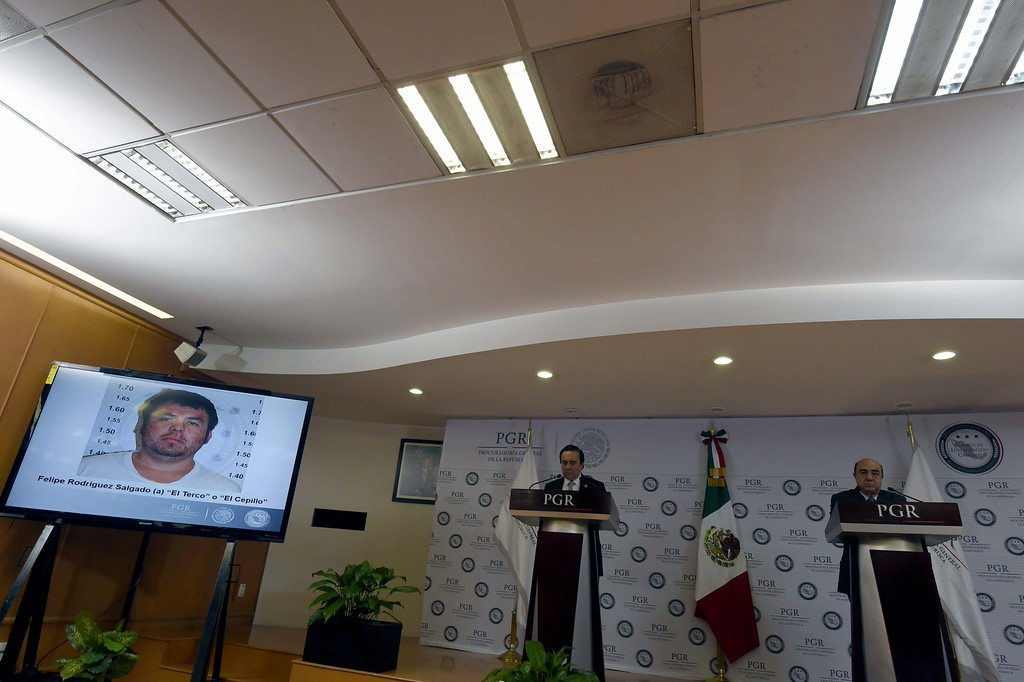 """. Mexico\'s Attorney General Jesus Murillo Karam (R) speaks next to the director of the Criminal Investigation Agency Tomas Zeron, during a press conference in Mexico City on January 27, 2015. Murillo Karam said the investigation gave them \""""the legal certainty that the student teachers were killed\"""". Witness and expert testimony \""""have allowed us to... come to the conclusion beyond a doubt that the students were abducted and killed, before being incinerated and thrown into the San Juan river, in that order,\"""" he said.         (ALFREDO ESTRELLA/AFP/Getty Images)"""