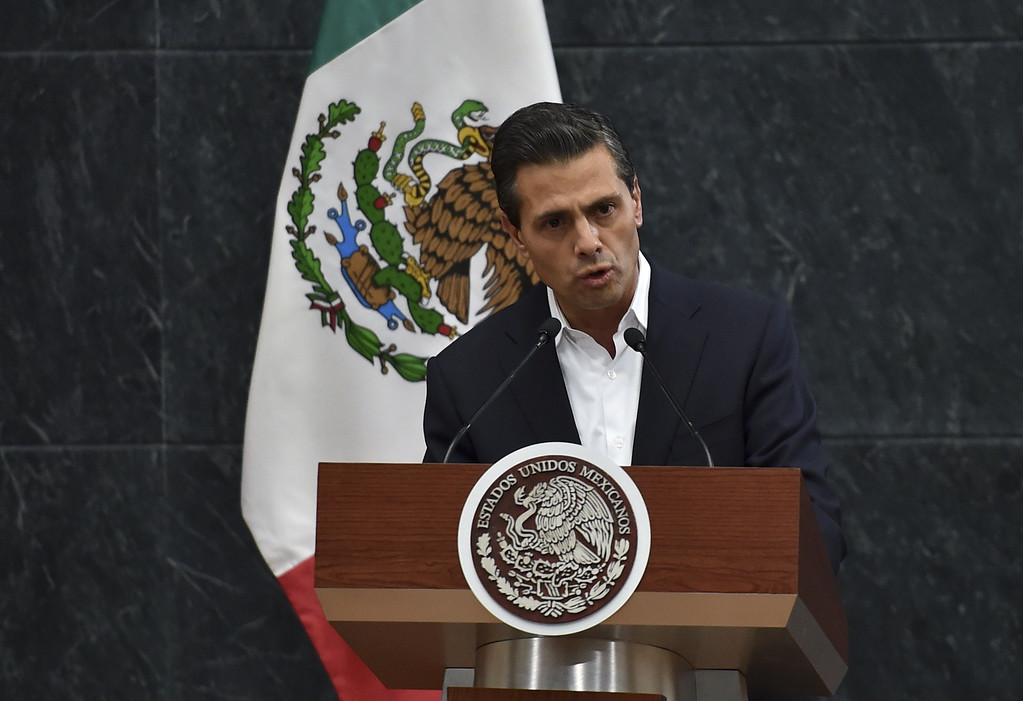 . Mexico\'s President Enrique Pena Nieto delivers a message to the press after a meeting with parents of 43 missing students at the Los Pinos presidential palace in Mexico City on October 29, 2014. President Enrique Pena Nieto has met for the first time with families of 43 students who went missing over a month ago in violence involving police and drug gang hitmen. The case of the missing in Guerrero state has shocked Mexico -- a country weary of years of mostly drug gang-linked violent crime -- and brought thousands to the streets demanding justice.          (YURI CORTEZ/AFP/Getty Images)