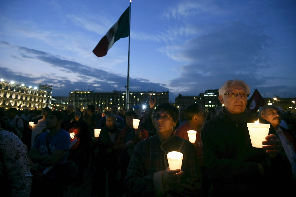 . People take part in a march commemorating four months of the disappearance of 43 students from Ayotzinapa, on January 26, 2015, at the Zocalo square in Mexico City. The students went missing on September 26, in an apparent massacre by a police-backed gang that sparked nationwide protests and caused a crisis for President Enrique Pena Nieto. For now, only one of the students has been positively identified from charred remains, which leaves little hope of finding the 42 others --what it would rank among the worst mass murders in a drug war that has killed more than 80,000 people and left 22,000 others missing since 2006 in Mexico.         (ALFREDO ESTRELLA/AFP/Getty Images)
