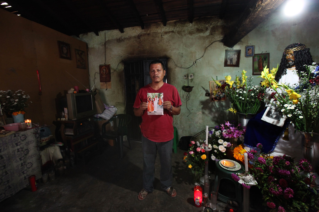. In this Nov. 9, 2014 photo, Clemente Rodriguez holds a photo of his missing son Christian Rodriguez Telumbre during an interview in his home in Tixtla, Mexico. The 19-year-old son of Rodriguez is one of the 43 Rural Normal School of Ayotzinapa students who were last seen in the custody of police in the city of Iguala, allegedly at the behest of the mayor. Rodriguez and his wife hold fast to the belief that their son who loved folk dancing is alive. (AP Photo/Marco Ugarte)