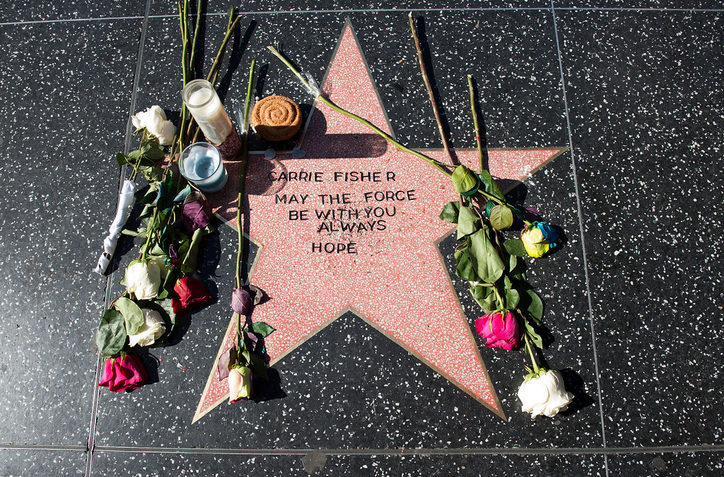 ". A view of a temporary star made by fans in tribute to actress Carrie Fisher on Hollywood Walk of Fame in Hollywood, California, on December 28, 2016. Friends, fans and Hollywood stars added their voices to a torrent of tributes for ""Star Wars\"" actress Carrie Fisher, who died Tuesday at the age of 60 following a heart attack. (VALERIE MACON/AFP/Getty Images)"