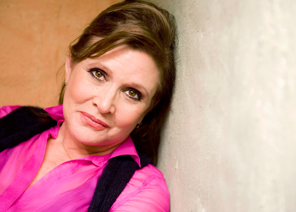 . Actress Carrie Fisher poses during an interview at her home in Coldwater Canyon in 2012. On Tuesday, Dec. 27, 2016, a publicist said Fisher has died at the age of 60. Fisher was rushed to a hospital after reportedly suffering cardiac arrest on Friday, December 23, 2016,  aboard a flight from London to Los Angeles.  (File photo by Leonard Ortiz, Orange County Register/SCNG)