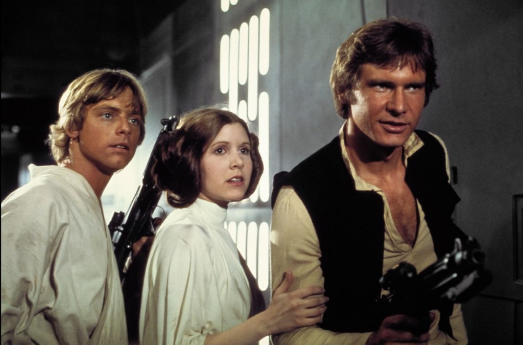. Mark Hamill, Carrie Fisher and Harrison Ford in Star Wars: Episode IV - A New Hope On Tuesday, Dec. 27, 2016, a publicist said Fisher died at the age of 60. Fisher was rushed to a hospital after reportedly suffering cardiac arrest on Friday, December 23, 2016,  aboard a flight from London to Los Angeles. (1977) (Lucasfilm Ltd.)