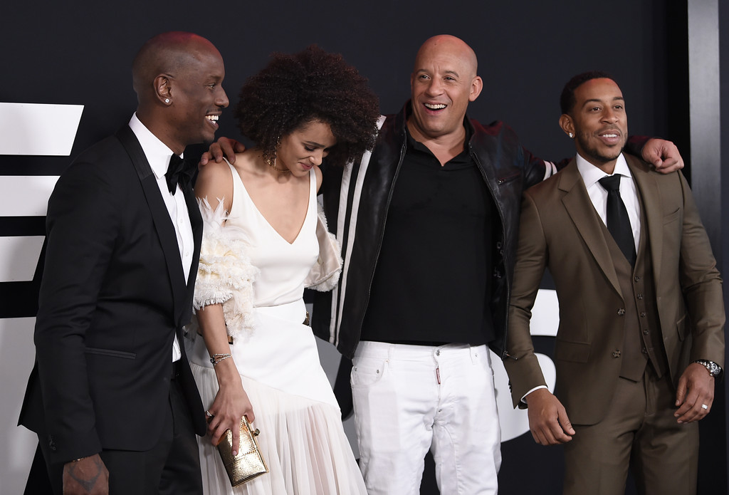 ". Tyrese Gibson, from left, Nathalie Emmanuel, Vin Diesel and Ludacris attend the world premiere of Universal Pictures\' ""The Fate of the Furious\"" at Radio City Music Hall on Saturday, April 8, 2017, in New York. (Photo by Evan Agostini/Invision/AP)"