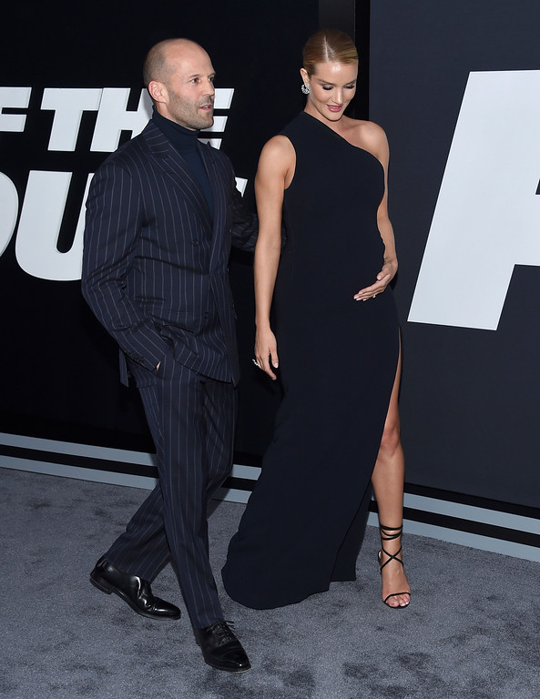 """. Jason Statham, left, and Rosie Huntington-Whiteley attend the world premiere of Universal Pictures\' \""""The Fate of the Furious\"""" at Radio City Music Hall on Saturday, April 8, 2017, in New York. (Photo by Evan Agostini/Invision/AP)"""