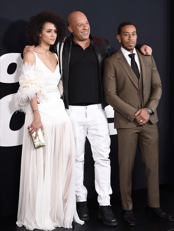 """. Nathalie Emmanuel, from left, Vin Diesel and Ludacris attend the world premiere of Universal Pictures\' \""""The Fate of the Furious\"""" at Radio City Music Hall on Saturday, April 8, 2017, in New York. (Photo by Evan Agostini/Invision/AP)"""