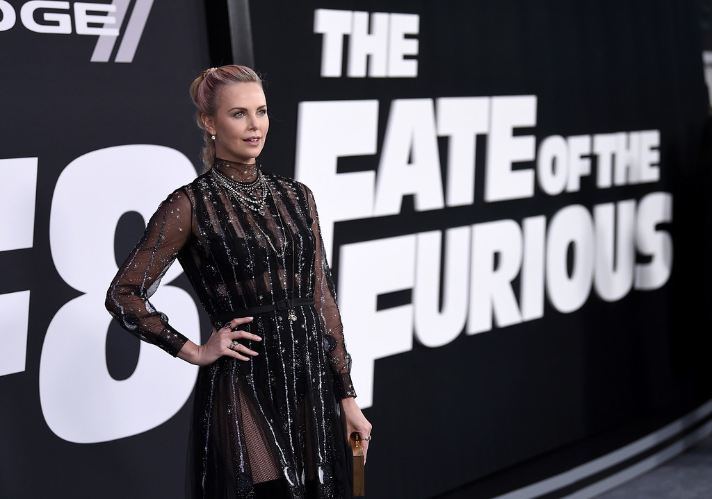 """. Charlize Theron attends the world premiere of Universal Pictures\' \""""The Fate of the Furious\"""" at Radio City Music Hall on Saturday, April 8, 2017, in New York. (Photo by Evan Agostini/Invision/AP)"""