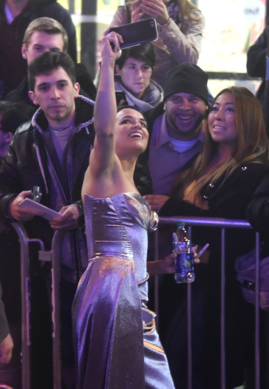 """. Michelle Rodriguez takes a selfie with fans as she attends the world premiere of Universal Pictures\' \""""The Fate of the Furious\"""" at Radio City Music Hall on Saturday, April 8, 2017, in New York. (Photo by Evan Agostini/Invision/AP)"""