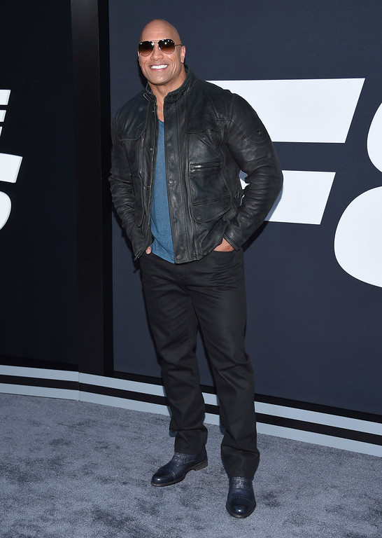 ". Dwayne Johnson attends the world premiere of Universal Pictures\' ""The Fate of the Furious\"" at Radio City Music Hall on Saturday, April 8, 2017, in New York. (Photo by Evan Agostini/Invision/AP)"