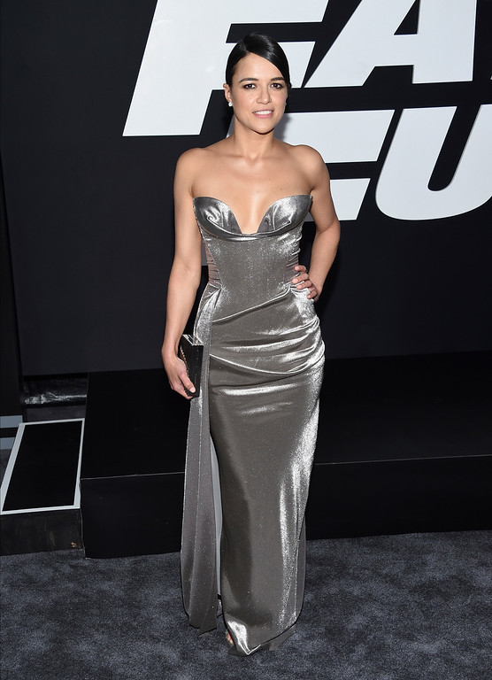 ". Michelle Rodriguez attends the world premiere of Universal Pictures\' ""The Fate of the Furious\"" at Radio City Music Hall on Saturday, April 8, 2017, in New York. (Photo by Evan Agostini/Invision/AP)"