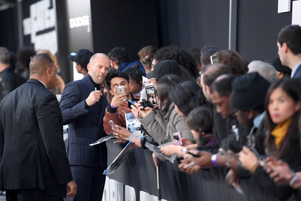 ". NEW YORK, NY - APRIL 08: Actor Jason Statham poses for selfies with fans at ""The Fate Of The Furious\"" New York Premiere at Radio City Music Hall on April 8, 2017 in New York City.  (Photo by Dimitrios Kambouris/Getty Images)"