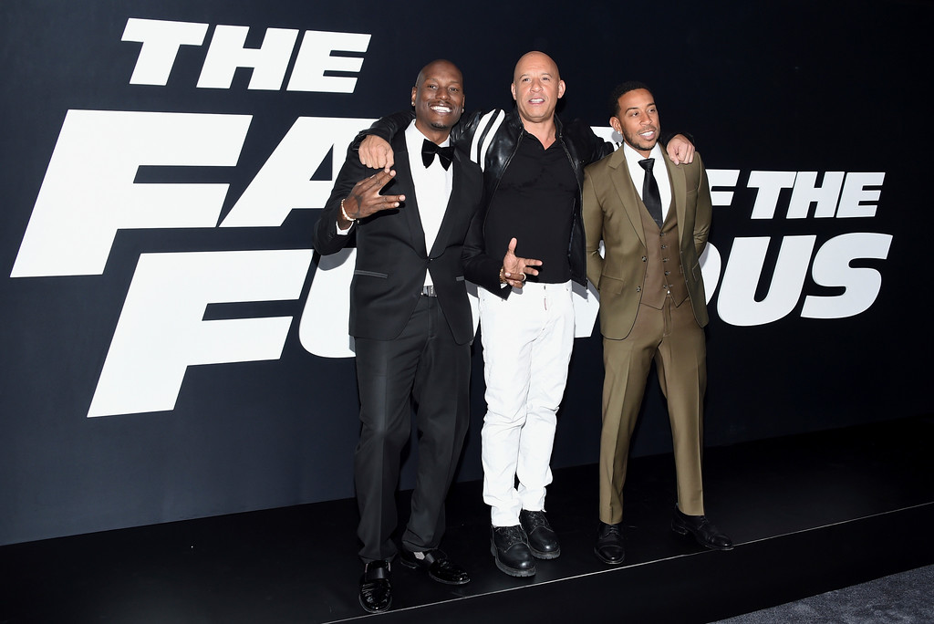 ". Tyrese Gibson, from left, Vin Diesel and Ludacris attend the world premiere of Universal Pictures\' ""The Fate of the Furious\"" at Radio City Music Hall on Saturday, April 8, 2017, in New York. (Photo by Evan Agostini/Invision/AP)"