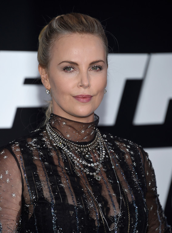 ". Charlize Theron attends the world premiere of Universal Pictures\' ""The Fate of the Furious\"" at Radio City Music Hall on Saturday, April 8, 2017, in New York. (Photo by Evan Agostini/Invision/AP)"