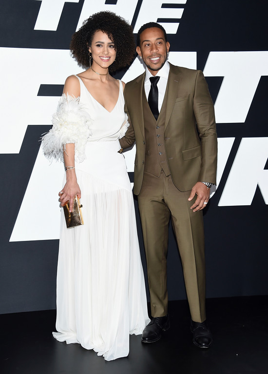 """. Nathalie Emmanuel, left, and Ludacris attend the world premiere of Universal Pictures\' \""""The Fate of the Furious\"""" at Radio City Music Hall on Saturday, April 8, 2017, in New York. (Photo by Evan Agostini/Invision/AP)"""