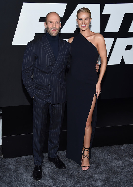 ". Jason Statham, left, and Rosie Huntington-Whiteley attend the world premiere of Universal Pictures\' ""The Fate of the Furious\"" at Radio City Music Hall on Saturday, April 8, 2017, in New York. (Photo by Evan Agostini/Invision/AP)"