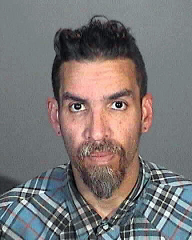 . This March 12, 2015 booking photo provided by the Glendale, Calif., Police Department shows Derick Ion Almena. Almena is an operator of the Ghost Ship warehouse in Oakland, in which dozens of people died in a fire that started Dec. 2, 2016. Spokeswoman Tawnee Lightfoot says Almena was stopped for driving with expired registration and, after a consensual search, two license plates from Oakland-area stolen cars were found. The charges apparently were not pursued.  (Glendale Police Department via AP)