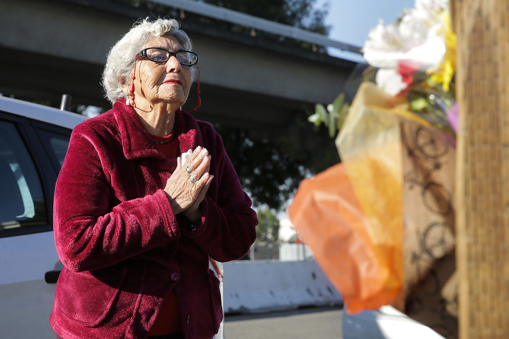 . On Sunday, Lidia Marquez prays near the site of a warehouse fire that has claimed the lives of at least 30 people in Oakland, California. The fire took place during a musical event late Friday night. (Photo by Elijah Nouvelage/Getty Images)