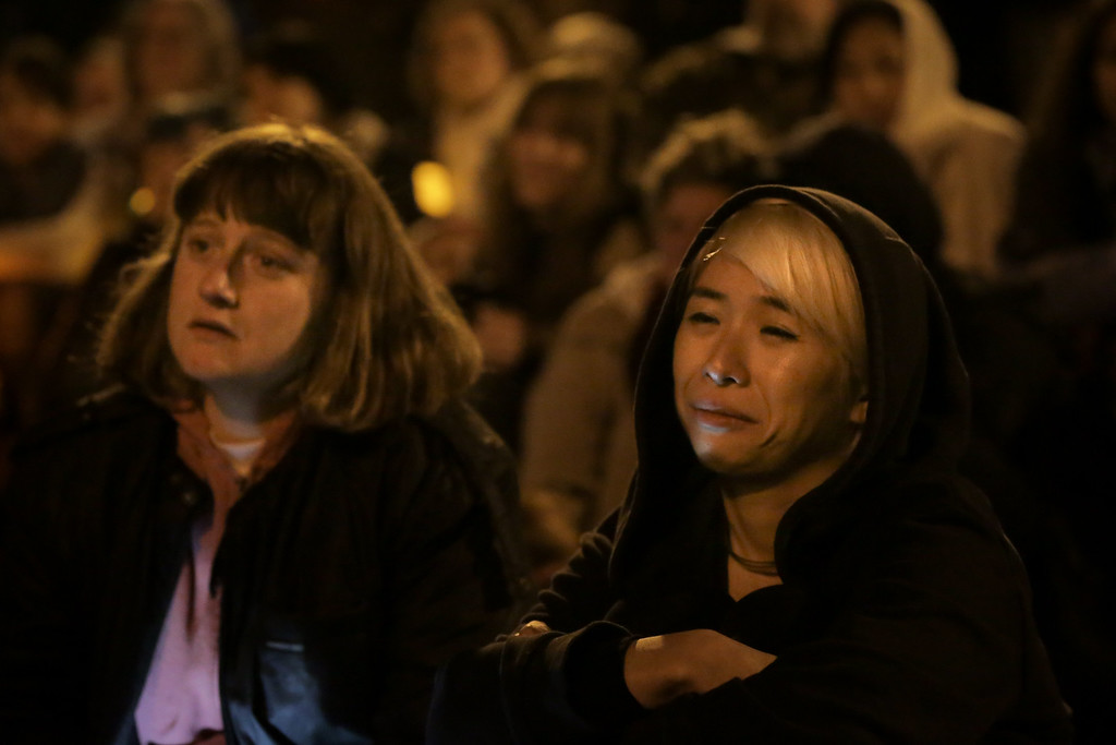 . OAKLAND, CA - DECEMBER 05: Two women attend a vigil for the victims of a warehouse fire that has claimed the lives of at least thirty-six people on December 5, 2016 in Oakland, California. The fire took place during a musical event late Friday night. (Photo by Elijah Nouvelage/Getty Images)