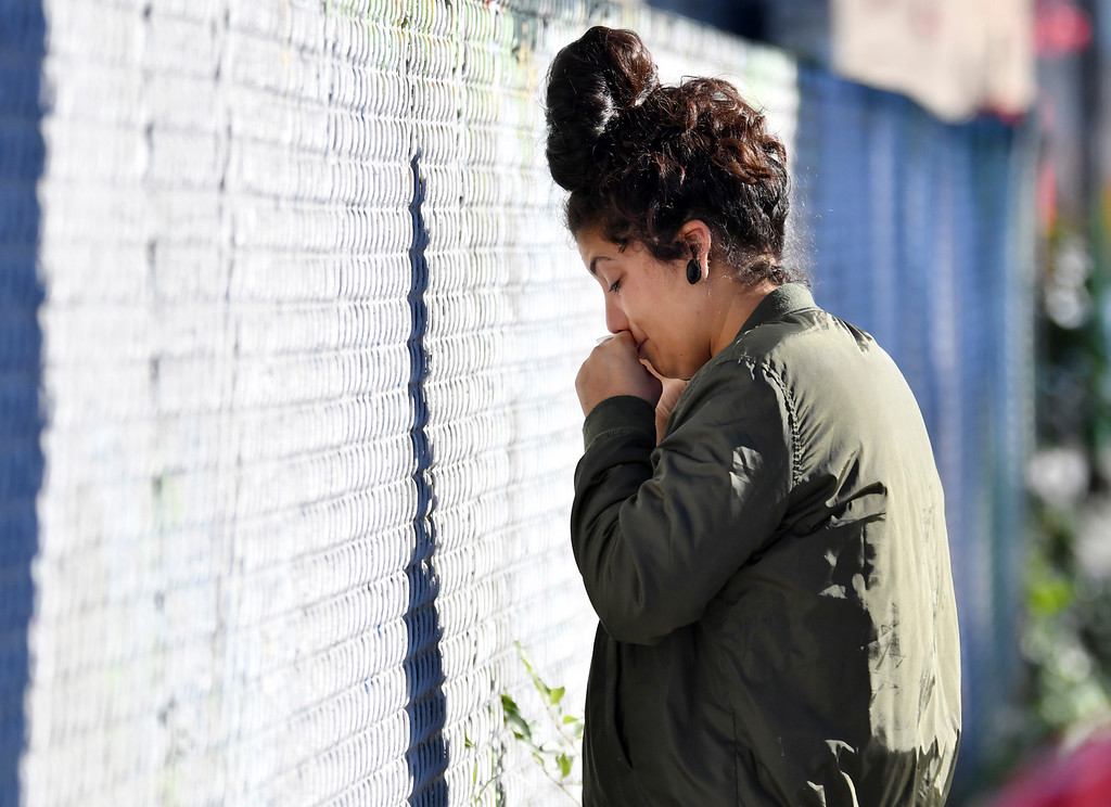 . A woman cries at the scene of a warehouse fire Saturday, Dec. 3, 2016, in Oakland, Calif. A deadly fire broke out during a rave at the converted warehouse in the San Francisco Bay Area. (AP Photo/Josh Edelson)