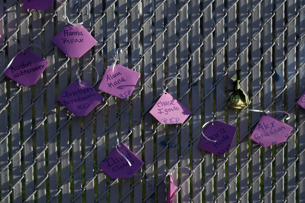 . Victims names are written on a fence at a makeshift memorial near the site of a warehouse fire Tuesday, Dec. 6, 2016, in Oakland, Calif. (AP Photo/Marcio Jose Sanchez)