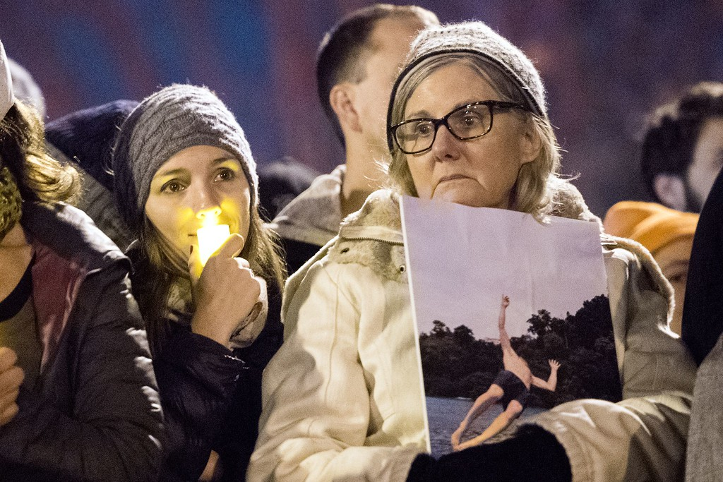 . A woman holds a photo of her son during a vigil honoring those who died in a warehouse fire in Oakland, California on December 5, 2016. The death toll from the massive weekend fire at a warehouse near San Francisco shot up to 36 on December 5 as authorities launched a criminal probe and pushed forth with recovery efforts. (JOSH EDELSON/AFP/Getty Images)