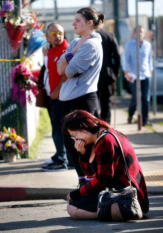 . Roxy Blank grieves for her boyfriend outside the fatal warehouse fire scene on East 12th Street in Oakland, Calif., Sunday, Dec. 4, 2016. She says her boyfriend was at the party Friday night, but declined to say more. (Photo by Karl Mondon/Bay Area News Group)