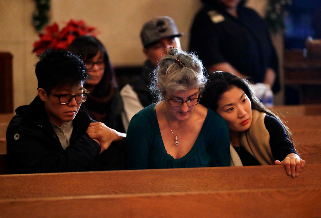 . Attendees embrace during a memorial for victims of a warehouse fire at Chapel of the Chimes Saturday, Dec. 3, 2016, in Oakland, Calif. Firefighters struggled to get to bodies in the rubble Saturday after a deadly fire tore through a converted Oakland warehouse during a late-night electronic music party Friday, making the charred structure unsafe for emergency crews to enter. (AP Photo/Marcio Jose Sanchez)