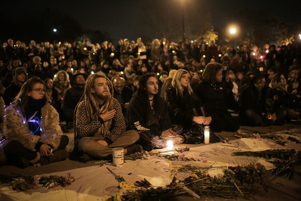 . OAKLAND, CA - DECEMBER 05: Hundreds of people attend a vigil for the victims of a warehouse fire that has claimed the lives of at least thirty-six people on December 5, 2016 in Oakland, California. The fire took place during a musical event late Friday night. (Photo by Elijah Nouvelage/Getty Images)