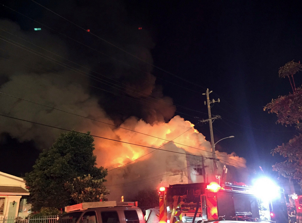 . This photo provided by @seungylee14  shows the scene of a fire in Oakland, early Saturday, Dec. 3, 2016.   The blaze began at about 11:30 p.m. on Friday during a party at a warehouse in the San Francisco Bay Area city.  Several people were unaccounted for.  (@seungylee14 via AP)