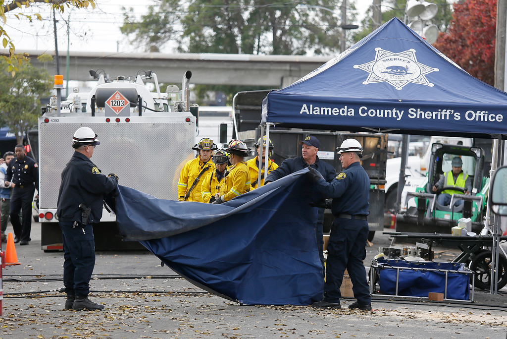 . Members of the Alameda County Sheriff\'s Office pack up gear outside the site of a warehouse fire Wednesday, Dec. 7, 2016, in Oakland, Calif. Recovery efforts at the site have ended officials said Wednesday. (AP Photo/Eric Risberg)