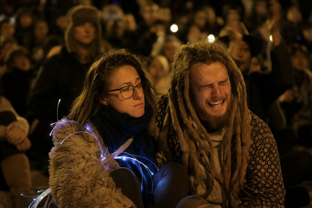 . OAKLAND, CA - DECEMBER 05: A man becomes emotional during a vigil for the victims of a warehouse fire that has claimed the lives of at least thirty-six people on December 5, 2016 in Oakland, California. The fire took place during a musical event late Friday night. (Photo by Elijah Nouvelage/Getty Images)
