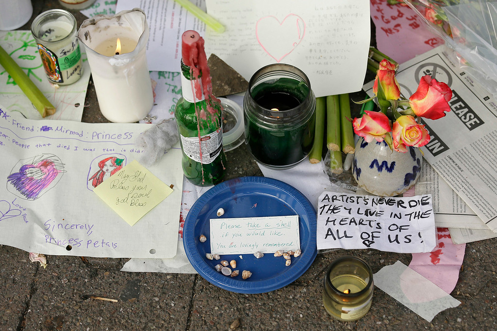 . Candles burn and notes are left at a makeshift memorial near the site of a warehouse fire Wednesday, Dec. 7, 2016, in Oakland, Calif. Recovery efforts at the Oakland warehouse fire have ended officials said Wednesday. (AP Photo/Eric Risberg)
