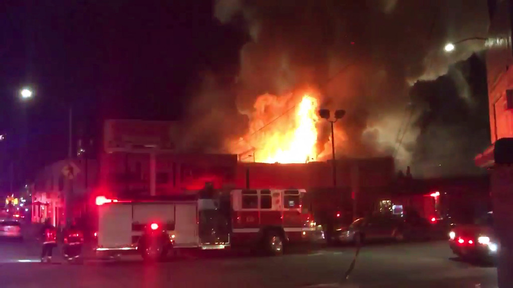 . This photo taken from video provided by @Oaklandfirelive shows the scene of a fire in Oakland, early Saturday, Dec. 3, 2016. The blaze began at about 11:30 p.m. on Friday during a party at a warehouse in the San Francisco Bay Area city.  Several people were unaccounted for.   Oakland Fire Department posted several messages throughout the night on its Twitter social media network account, including the latest one in the morning saying that fire crews would remain on the scene for several more hours to extinguish hot spots.    (@Oaklandfirelive via AP)