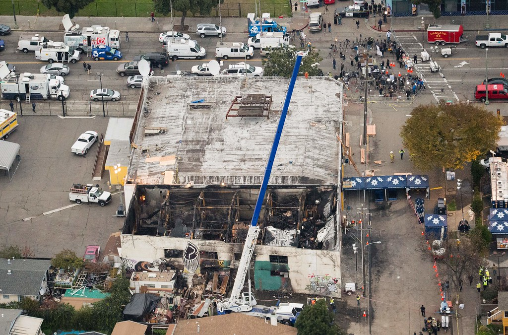 . A crane is used to lift wreckage as part of search efforts in a fire-ravaged warehouse on December 05, 2016 in Oakland, California.  The death toll from a massive weekend fire at a warehouse near San Francisco shot up to 36, as authorities launched a criminal probe and pushed forth with recovery efforts. (JOSH EDELSON/AFP/Getty Images)