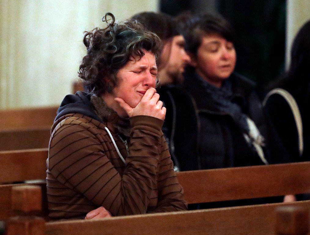 . Genevieve Griseau cries as she attends a memorial for victims of a warehouse fire at Chapel of the Chimes Saturday, Dec. 3, 2016, in Oakland, Calif. Griseau has friends that were in the warehouse and are unaccounted. Firefighters struggled to get to bodies in the rubble Saturday after a deadly fire tore through a converted Oakland warehouse during a late-night electronic music party Friday, and making the charred structure unsafe for emergency crews to enter. (AP Photo/Marcio Jose Sanchez)